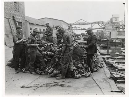 Fishermen mending fish nets, East San Pedro, Los Angeles Harbor district, General Subjects Photography Collection