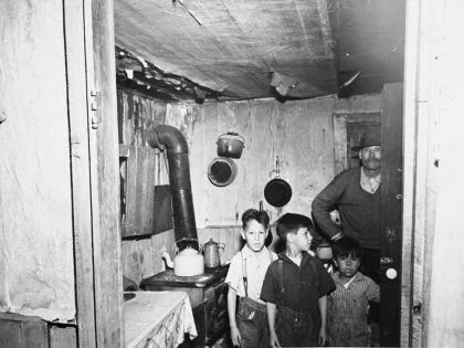 M.S. Siegel photograph of the interior of a residence for the Los Angeles Bureau of Housing and Sanitation, 1938, Poor Housing Conditions in Los Angeles Scrapbook