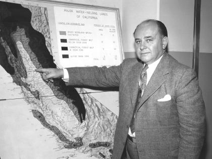 Frank Lanterman, CA State Assemblyman, in front of water map, c. 1950s